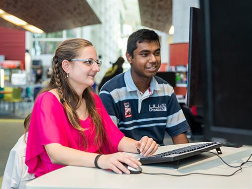 International students work together on the computer pods in the Palmerston North atrium