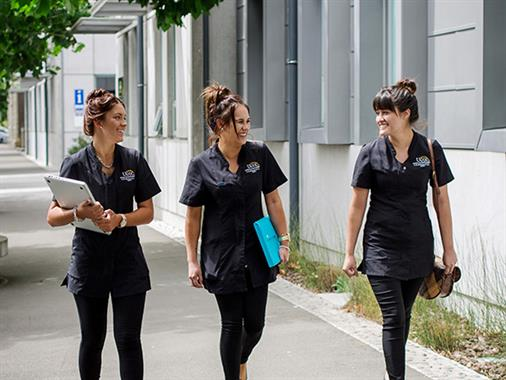 Three UCOL beauty students in uniform