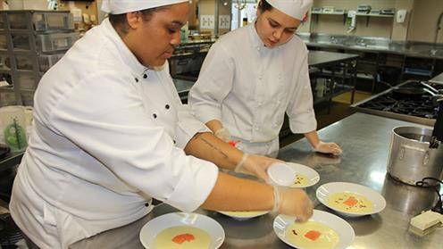 Culinary students plating up