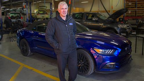 Ford Technical Trainer Don Rubie with the prototype Ford Mustang.