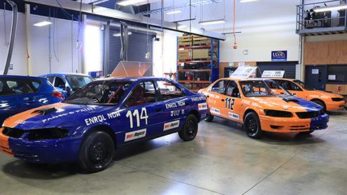 A photograph of UCOL speedway cars in the automotive workshop