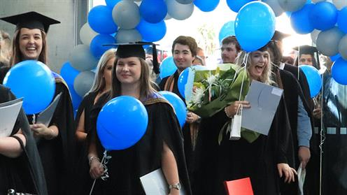 A photograph of a UCOL graduation procession