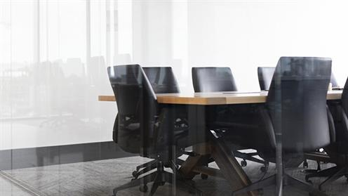 A photograph of a meeting room. Image by Drew Beamer courtesy of unsplash.com.