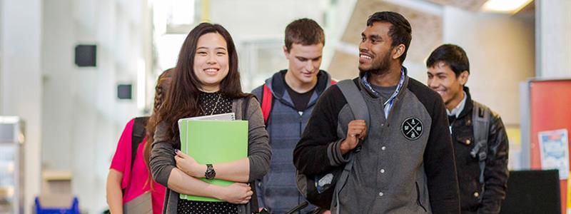 A photograph of a group of UCOL students in The Atrium at the Palmerston North campus