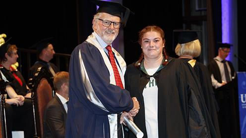 A photograph of Caitlyn Nevard-Tolley at UCOL's Graduation Ceremony.