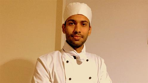 A photograph of UCOL Cookery Graduate Sajin Joseph in his chef uniform.